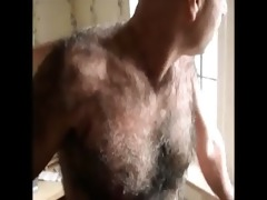 curly old fellow showing his body
