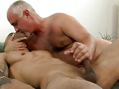 sexy tattooed gay giving tugjob to his older daddy