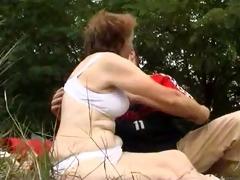 milf has sex on blanket in park