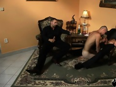 2 muscular fellows in suits receive serviced by