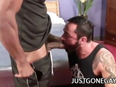 muscle dark stud copulates a white tattooed bear