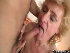 golden-haired granny jumps on his youthful cock
