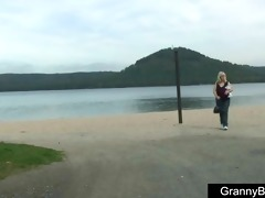 old blonde is banged by young lad outdoors