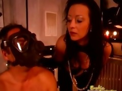 slave wears gasmask and receives tortured by