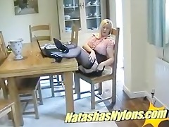 english milf in silk stockings gives footjob