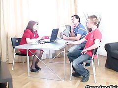 mature boss takes two cocks at office