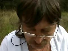 nurse treats old jock outdoors
