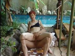 older redhead in bikini