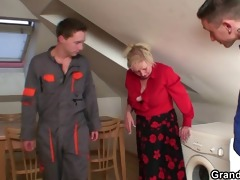 nasty granny widens her legs for two cocks